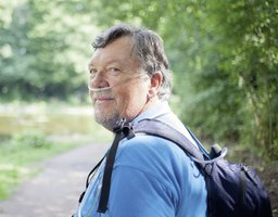 Man hiking with portable oxygen concentrator