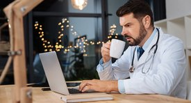 Doctor at his computer during shift work