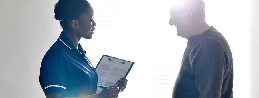 Caregiver providing support to a patient during follow-up