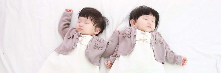 Identical twins sleeping